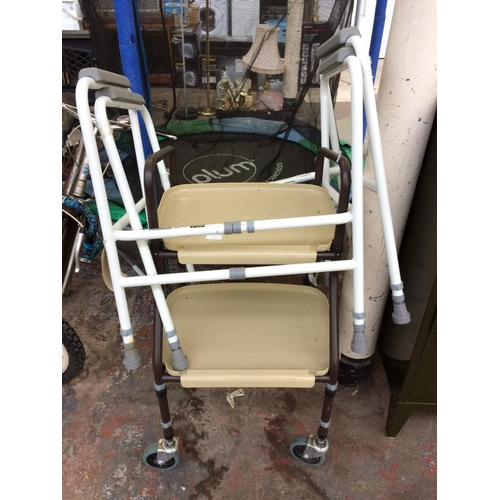 14 - THREE ITEMS OF MOBILITY EQUIPMENT TO INCLUDE TWO ADAPT TOILET FRAMES AND A FOUR WHEELED WALKING AID ...