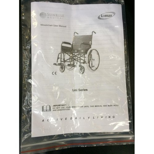 24 - A BLACK LOMAX FOLDING WHEELCHAIR IN AS NEW CONDITION WITH INSTRUCTION MANUAL...