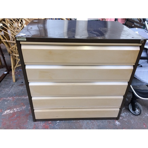 26 - A LARGE BROWN AND CREAM SEALINE FIVE DRAWER METAL OFFICE FILING CABINET WITH KEY...