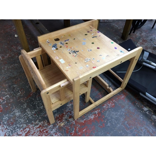 33 - A CHILD'S WOODEN DESK WITH MATCHING CHAIR...