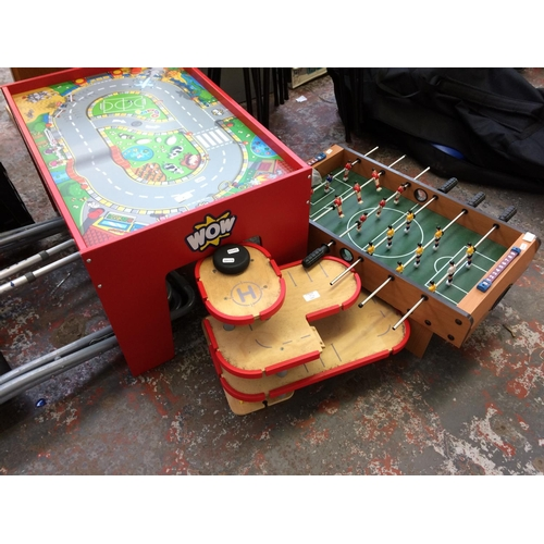 35 - THREE ITEMS TO INCLUDE A WOW CHILD'S PLAY TABLE, A SMALL TABLE FOOTBALL GAME AND WOODEN TOY CAR GARA...