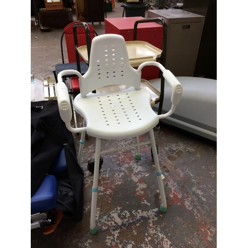 38 - TWO ITEMS OF MOBILITY EQUIPMENT TO INCLUDE A WHITE SHOWER CHAIR TOGETHER WITH A BROWN AND CREAM FOUR...