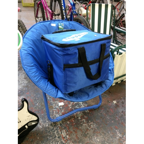 42 - TWO ITEMS TO INCLUDE A BLUE SAMSUNG COOL BAG TOGETHER WITH A BLUE FOLDING ASDA MOON CHAIR...
