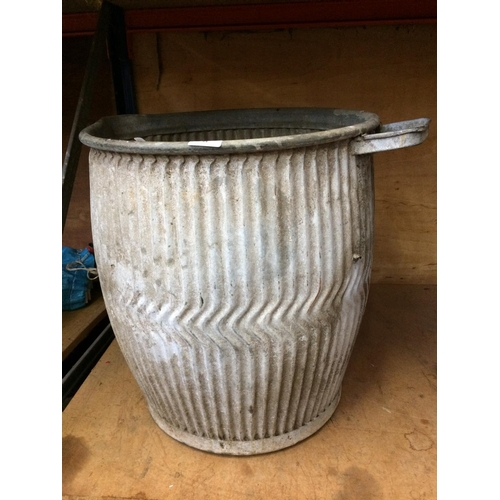 54 - AN UNUSUAL VINTAGE GALVANISED DOLLY TUB WITH SOAP TRAY AND SPOUT...