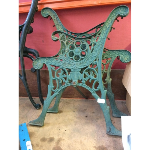 57 - A PAIR OF GREEN PAINTED CAST IRON ORNATE GARDEN BENCH ENDS...
