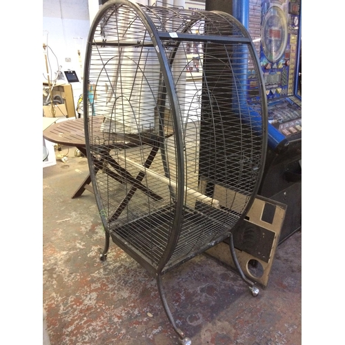 11 - A LARGE GREY METAL BIRD CAGE ON WHEELS...