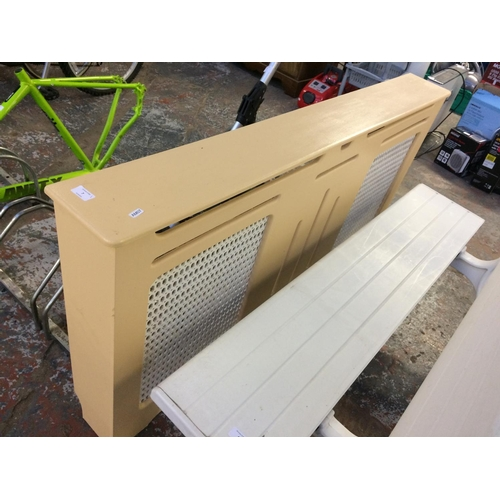 7 - A GOOD QUALITY CREAM PAINTED RADIATOR COVER...