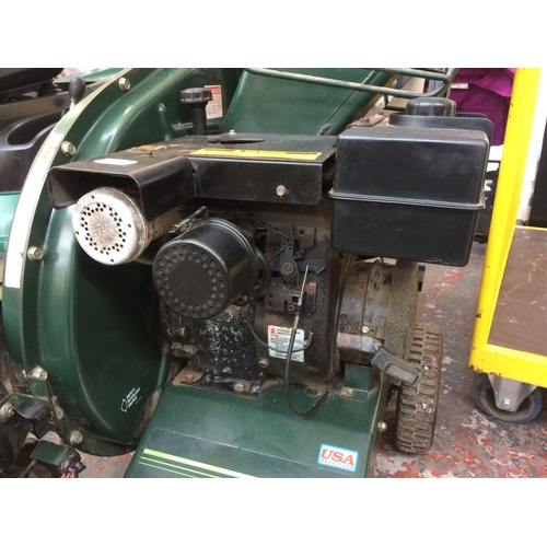 20 - A BLACK AND GREEN BOLENS PETROL CHIPPER/VACUUM WITH COLLECTOR (W/O - EX DEMO, REQUIRES SERVICE )...