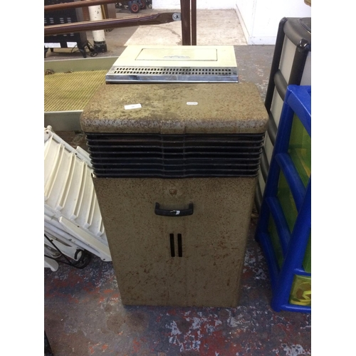 14 - TWO ITEMS - A VINTAGE AGNI PORTABLE GAS HEATER WITH BOTTLE AND REGULATOR AND A VINTAGE VALOR PARAFFI...
