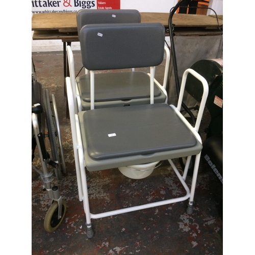 19 - TWO GREY AND WHITE ADAPT COMMODE CHAIRS...