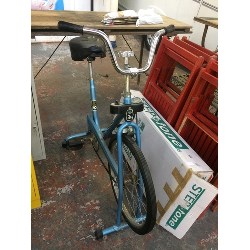 22 - TWO ITEMS - A VINTAGE BLUE HAWK CYCLES EXERCISE BIKE AND A BOXED STEP 'N' TONE EXERCISE STEP...