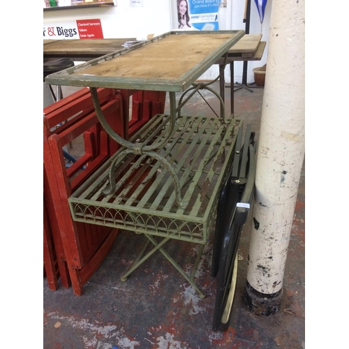 24 - THREE ITEMS - TWO GREEN PAINTED ORNATE METAL CONSERVATORY TABLES AND A FOLDING GREY METAL SUN LOUNGE...