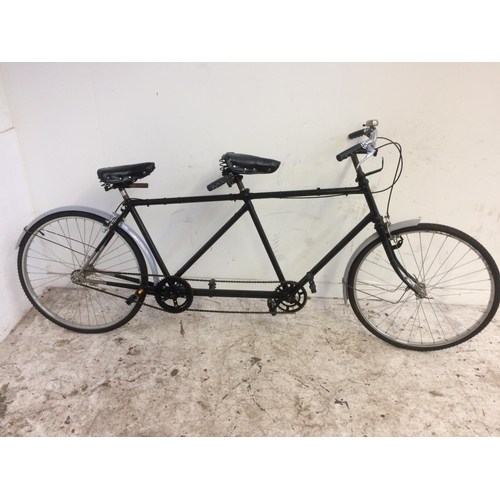 3 - A BLACK VINTAGE TANDEM BICYCLE WITH QUICK RELEASE WHEELS, SPRUNG SADDLE AND SINGLE GEAR SYSTEM...