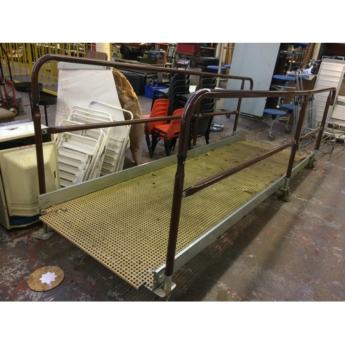 30 - A GOOD QUALITY BROWN PAINTED AND GALVANISED BUILDING DISABLED ACCESS RAMP WITH ANTI-SLIP TREAD AND A...