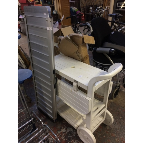 32 - THREE ITEMS - TWO ALUMINIUM VEHICLE ACCESS RAMPS AND A WHITE PLASTIC PLANT STAND...