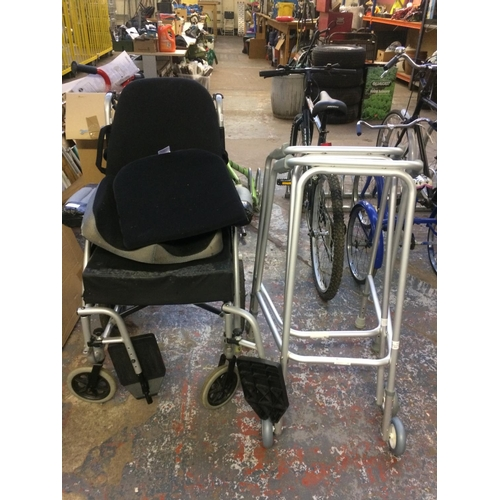 33 - THREE ITEMS - A BLACK AND GREY HARLEY LUXURY V FOLDING WHEELCHAIR AND TWO ALUMINIUM WALKING AIDS...
