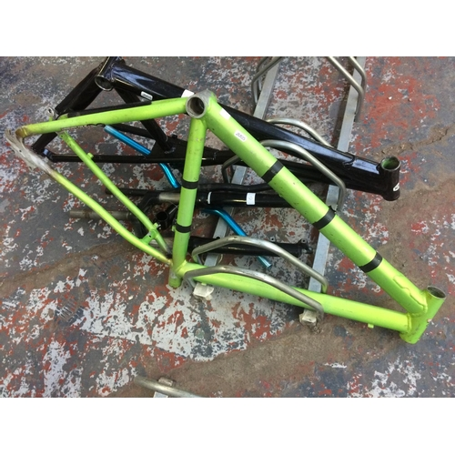 6 - A SELECTION OF BICYCLE SPARES TO INCLUDE ALUMINIUM FRAMES, LOCK OUT FRONT FORKS AND TWO SETS OF HAND...