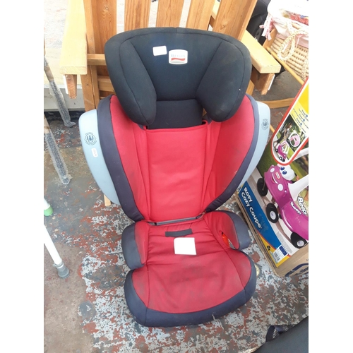 10 - A BLACK RED AND GREY BRITAX CHILDS CAR SEAT...