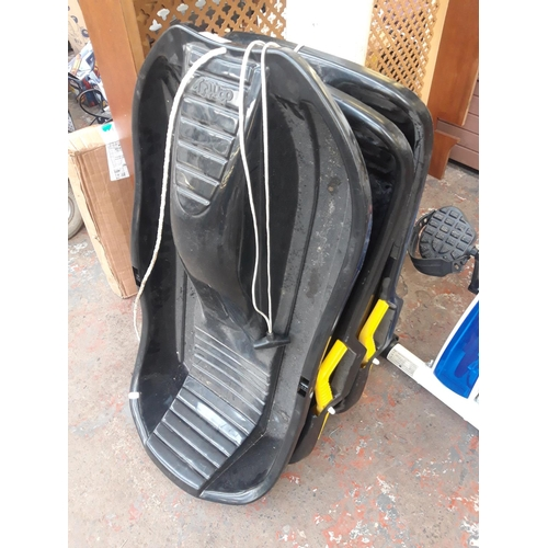 17 - THREE BLACK PLASTIC SLEDGES, TWO SNO-RIDER AND ONE DAN TOY...