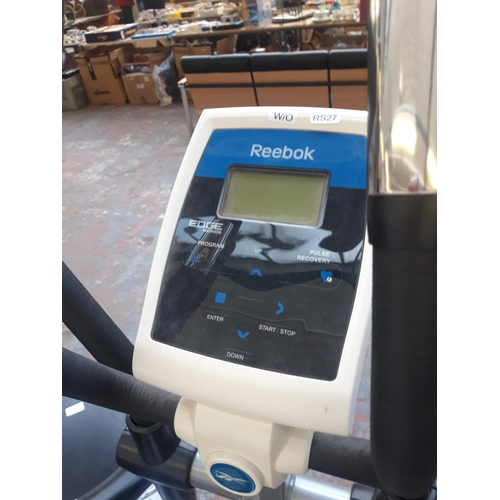 20 - A GREY AND WHITE REEBOK EDGE SERIES CROSS TRAINING MACHINE WITH DIGITAL READOUT (W/O)...