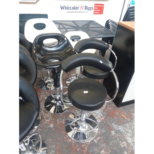 22 - FIVE VARIOUS HIGH BAR STOOLS TO INCLUDE BLACK PLASTIC, LEATHERETTE, AND WHITE PLASTIC...