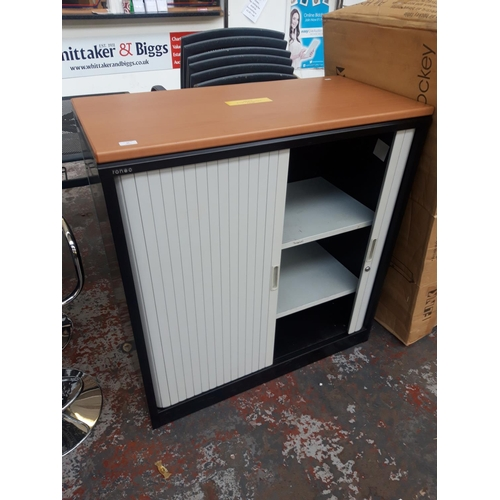 23 - A BLACK METAL AND WOOD EFFECT TONEO OFFICE STORAGE CABINET WITH INTERNAL SHELVING  AND CONCERTINA DO...