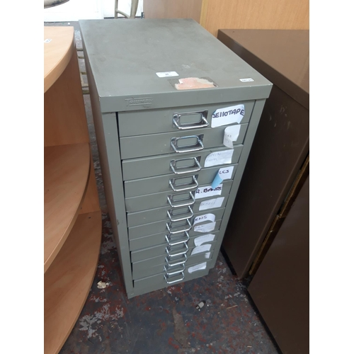26 - A GREY METAL TRIUMPH TWELVE DRAWER OFFICE FILING CABINET...