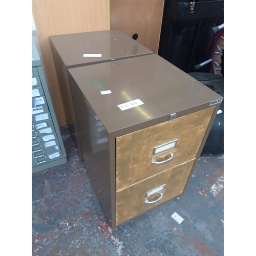 27 - TWO BROWN METAL TWO DRAWER OFFICE FILING CABINETS...