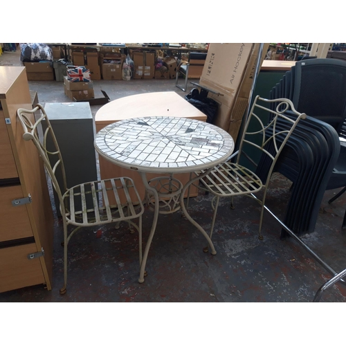 36 - AN UNUSUAL THREE PIECE CONSERVATORY SET COMPRISING CIRCULAR TILE TOP TABLE ON METAL SUPPORTS AND TWO...