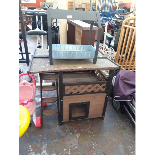 39 - TWO ITEMS TO INCLUDE A BLACK AND BROWN WOODEN PIGEON COOP WITH FELTED ROOF TOGETHER WITH A GALVANIZE...