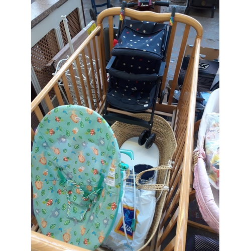 41 - EIGHT BABY ITEMS TO INCLUDE A GOOD QUALITY PINE COT, A FISHER PRICE CAR SEAT, A WICKER CRIB ON PINE ...
