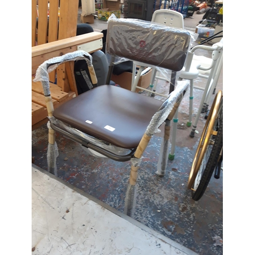 44 - A NEW AIDAPT COMMODE CHAIR...