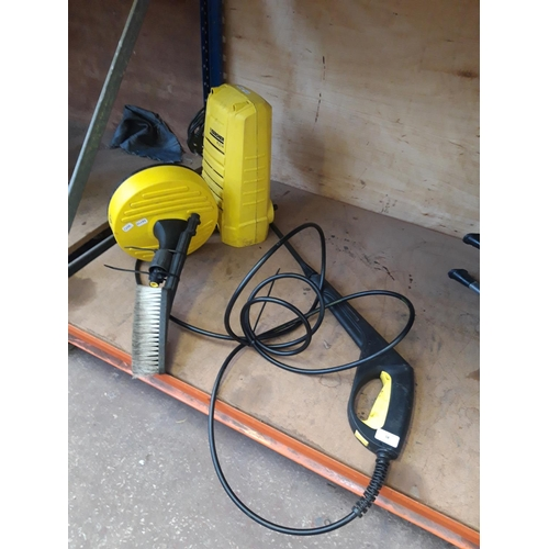 58 - A YELLOW KARCHER K2.14 ELECTRIC PRESSURE WASHER WITH HOSE, LANCE, BRUSH AND PATIO BRUSH (W/O)...
