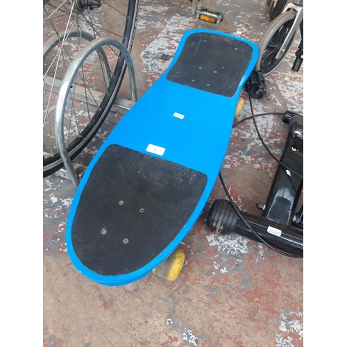 6 - A BLUE AND YELLOW SKATEBOARD WITH SKULL DESIGN...