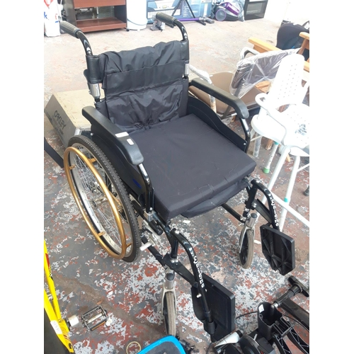 7 - A GOOD QUALITY BLACK AND GOLD WHEELTECH ENIGMA FOLDING WHEELCHAIR...