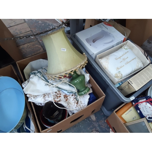 329 - FIFTEEN BOXES CONTAINING MIXED ITEMS TO INCLUDE VARIOUS QUARTZ WALL CLOCKS, TABLE LAMP, VINTAGE MAGA...