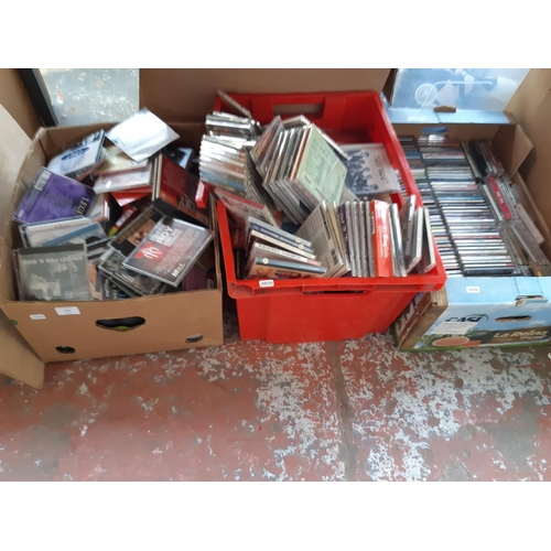 355 - THREE BOXES CONTAINING A LARGE COLLECTION OF CD'S TO INCLUDE RAT PACK, NAT KING COLE, ROCK & ROLL LE...