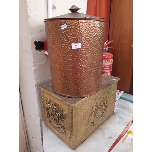 356 - TWO ITEMS TO INCLUDE AN EMBOSSED BRASS COAL BOX AND AN UNUSUAL HAMMERED COPPER CYLINDRICAL COAL BIN ...