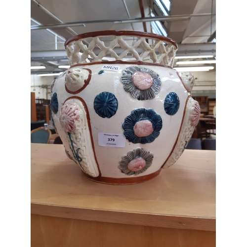 379 - A LATE VICTORIAN CERAMIC HAND PAINTED JARDINIERE...