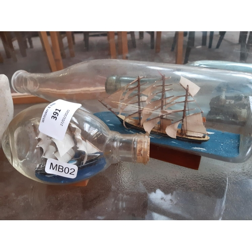 391 - FOUR VINTAGE SHIPS IN BOTTLES TOGETHER WITH AN UNUSUAL CERAMIC HAND FIGURE...