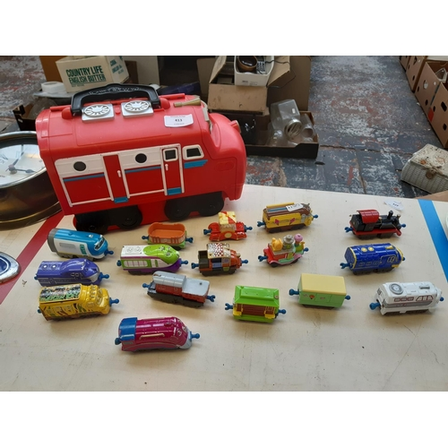 413 - A COLLECTION OF CHUGGINGTON LUDORUM LEARNING CURVE BRAND MODEL RAILWAY TOGETHER WITH A PLASTIC MODEL...
