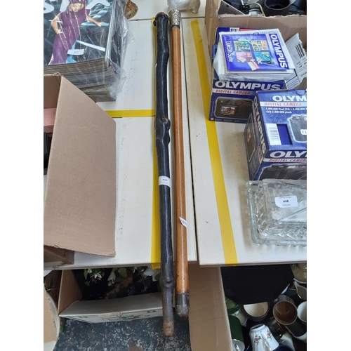 449 - TWO VINTAGE WALKING CANES TO INCLUDE ONE WALKING CANE WITH WHITE METAL TOP AND EMBOSSED GRAPE DESIGN...