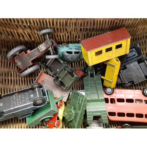 487 - A WICKER BASKET CONTAINING VARIOUS VINTAGE DIE CAST MODELS TO INCLUDE A LESNEY MATCHBOX SERIES MERRY...