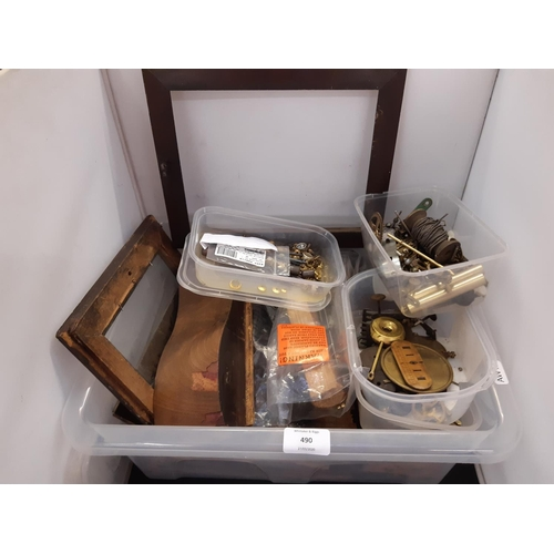 490 - A BOX CONTAINING VARIOUS CLOCK PARTS AND ACCESSORIES TO INCLUDE ART DECO PEG BALLS, CLOCK HANDS ETC....