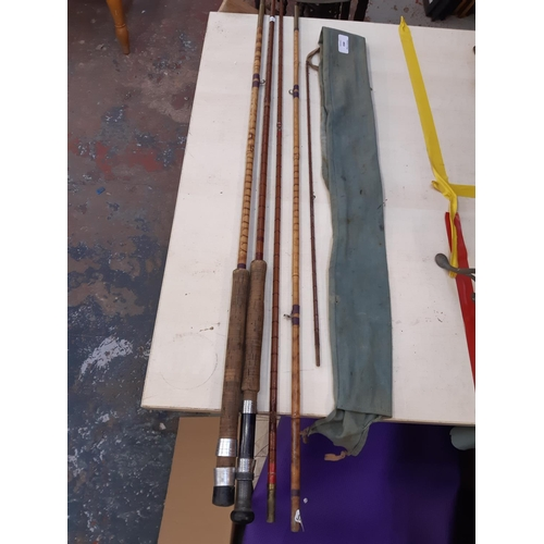 493 - A THREE SECTION SPLIT CANE FISHING ROD TOGETHER WITH ONE OTHER...