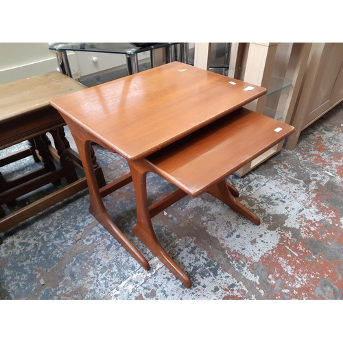 577 - A RETRO G-PLAN TEAK NEST OF TWO TABLES...