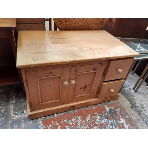 581 - A RUSTIC PINE TV STAND WITH TWO LOWER DOORS AND TWO DRAWERS...