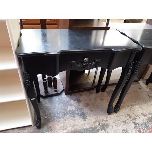 585 - A MODERN FRENCH STYLE BLACK PAINTED HALL TABLE WITH ONE DRAWER...