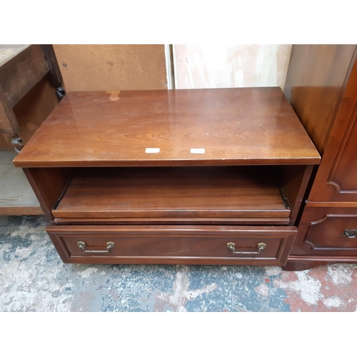 590 - A G-PLAN RED LABEL MAHOGANY TV UNIT WITH ONE LOWER DRAWER AND CASTER SUPPORTS...