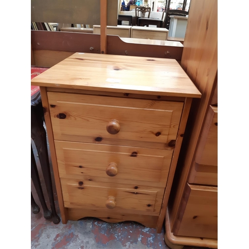 615 - A MODERN PINE BEDSIDE CHEST OF THREE DRAWERS...